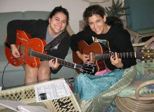 Maggie & I playing Beatles tunes on our guitars.
